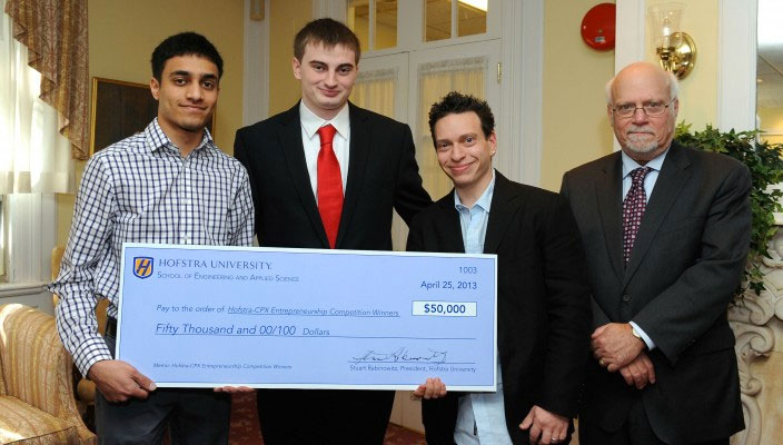 Copmuter Science students Michael Moskie and Shashank Sanjay accepting first place prize at the 2013 awards ceremony.