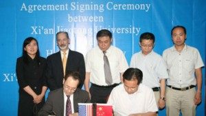 Herman Berliner, Hofstra Provost, Bernard Firestone, Dean of Hostra College of Liberal Arts and Sciences and Ying Qiu, DIrector of Hofstra's Asia Center participate in a signing ceremony wtih officials from Xi'an Jiaotong University