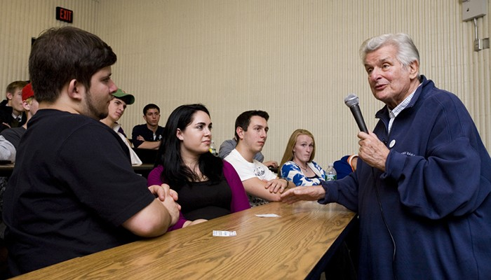 Sid Bernstein with Hofstra music merchandising students in 2009.