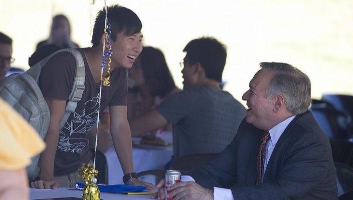 Dean Pat Socci greets a student