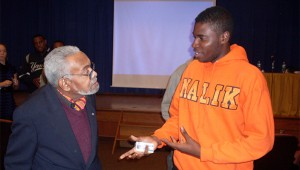 Amiri Baraka with a Hofstra student during his visit to campus in 2010.