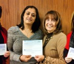 Business Plan Competition winners Laura Boehm, RItma Sood and Linda Scainetti with Associate Dean Judith Tyne (center).