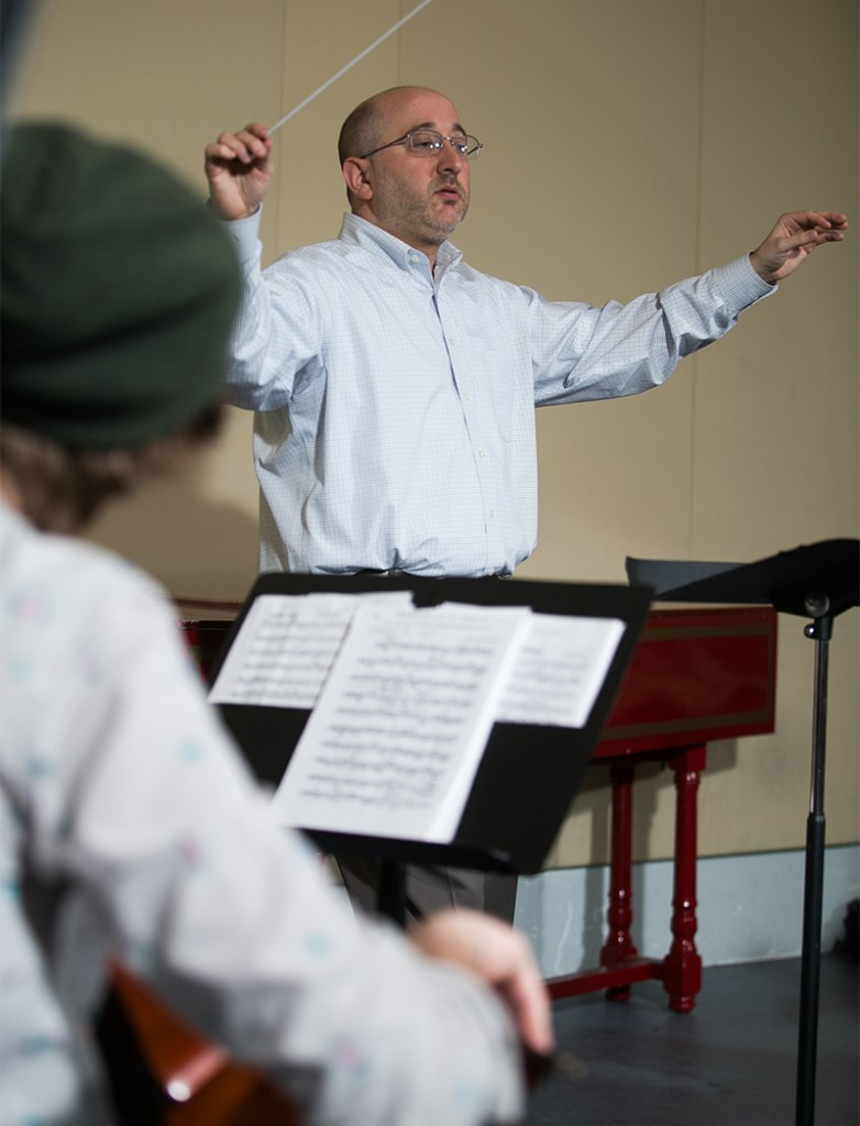 Symphony director Adam Glaser in rehearsal