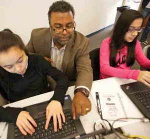 Dr. Robert Joseph works with students.