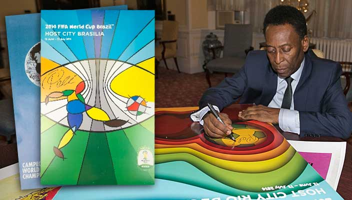 Pele signs commemorative posters during his visit to Hofstra University, April 11, 2014
