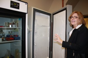 Biology Laboratory Director Carol St. Angelo with  the -80 degree freezer.