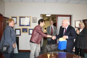 President Rabinowitz congratulates Robbie Rosen on his winning composition.