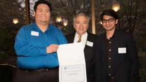 Outgoing Hofstra Tax Society President Stephen Siu, former Zarb School Dean Patrick Socci and club member Abdullah Bin Wasif.