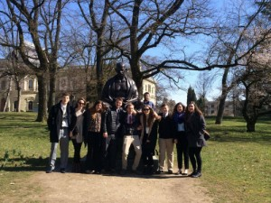Our intrepid travelers in Geneva, Switzerland, by the statue of Gandhi.