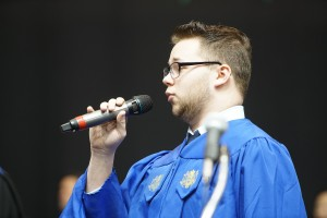 Alex Lavoie singing the National Anthem at midyear commencement in December.