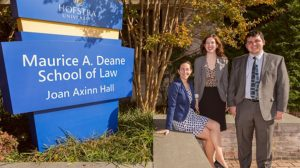 Betsey Nevins-Saunders (sitting) is the attorney-in-charge at the Criminal Justice Clinic at the Deane School of Law