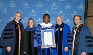 Soccer legend Pelé was awarded an honorary degree at Hofstra in 2014. (L to r) Dean Herman Berliner, Professor Brenda Elsey, Pelé, President Stuart Rabinowitz, and Professor Stanislao Pugliese.