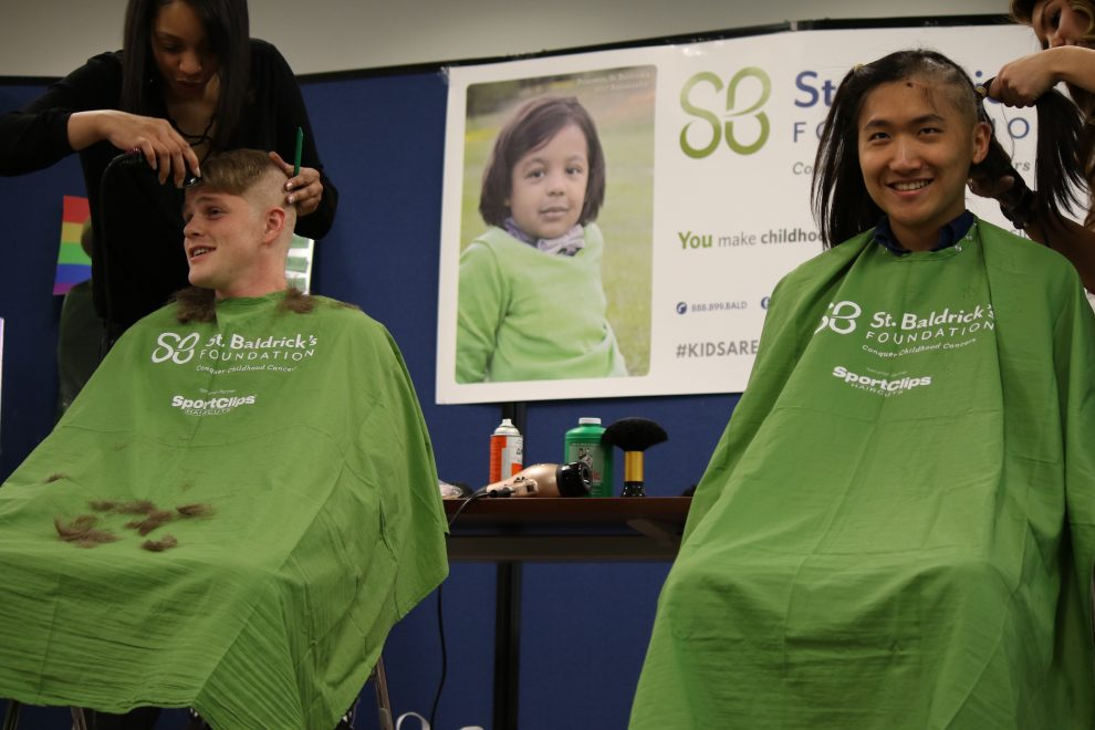 Med students, Levi Brown (left) and John Eun, brave the shave.