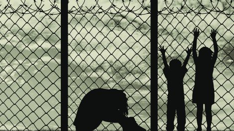 Concept of refugee. Silhouette of a refugee family, a mother in despair with children on the background of the border