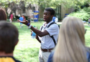 Student giving a tour on Hofstra's campus
