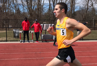 Student Ryan Connell running track