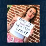 Dance Student hlding sign saying Covid-19 Cant Stop Hofstra Dance