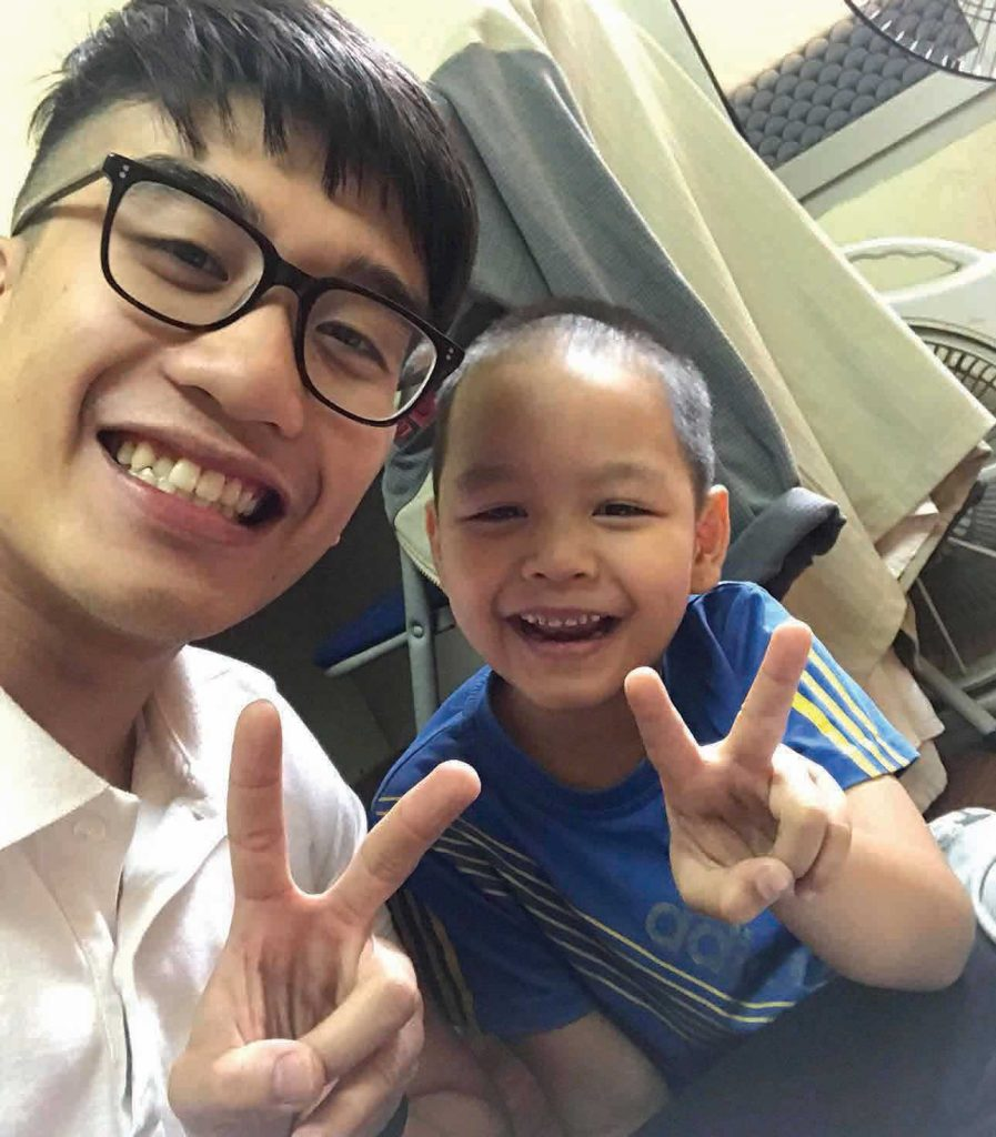 Child and adult smiling with peace signs
